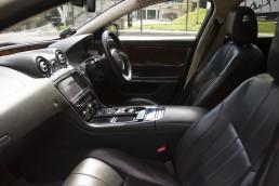 Front seats of white Jaguar XJL